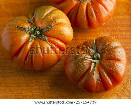 tomato on wooden - stock photo