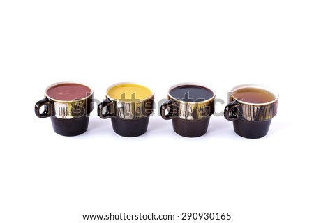 Tomato, orange, black grape and apple juices in ceramic cups isolated on white - stock photo