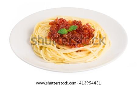 Tomato pasta spaghetti in a dish isolated on white background - stock photo