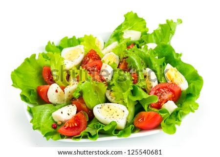 Tomato salad, quail eggs and mozzarella isolated on white background - stock photo