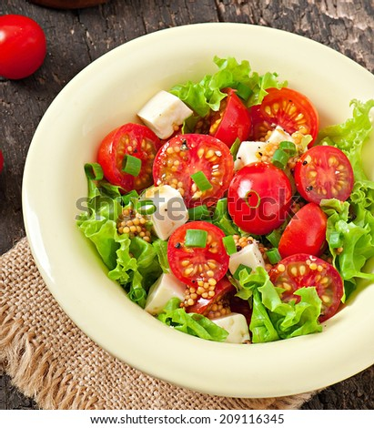 Tomato salad with lettuce, cheese and mustard and garlic dressing