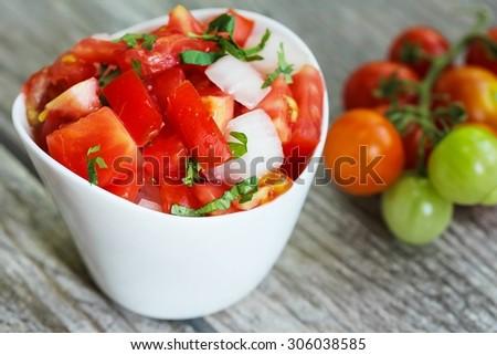 Tomato Salsa, shallow depth of field - stock photo