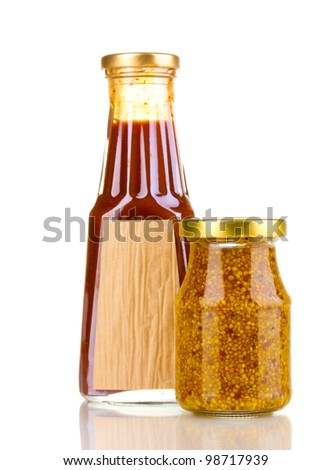 Tomato sauce and mustard in glass bottles isolated on white