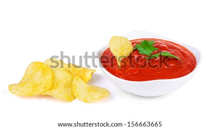 tomato sauce and potato chips on a white background