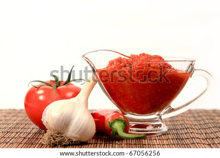 Tomato sauce and vegetables - stock photo