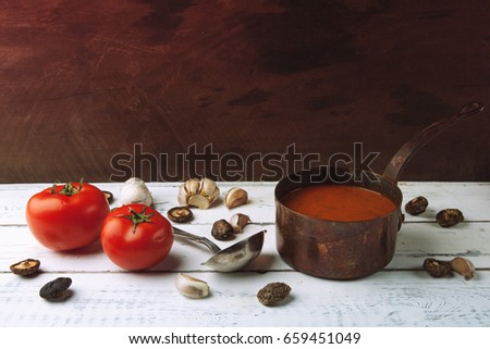 Tomato sauce for pizza in a saucepan. Copy space for text.