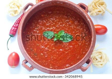 Tomato sauce in a clay pot, italy - stock photo