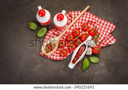 Tomato sauce in a sauce boat with fresh ingredients. Food background, Top view - stock photo