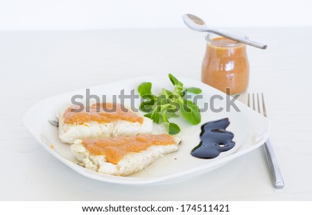 Tomato sauce. Plate of grilled fish with tomato sauce and vegetables