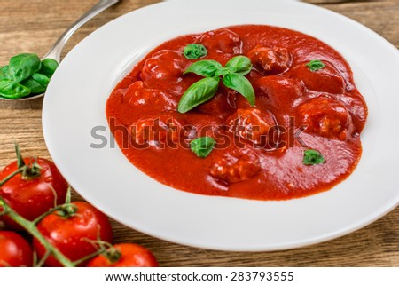 Tomato sauce with meat balls in white plate
