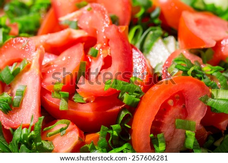 Tomato slices background with greens - stock photo