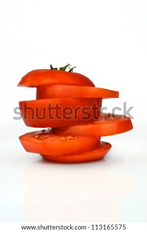 Tomato slices one each other - stock photo