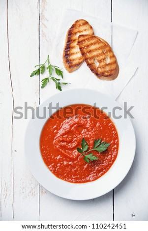 Tomato soup Gazpacho on white wood background - stock photo