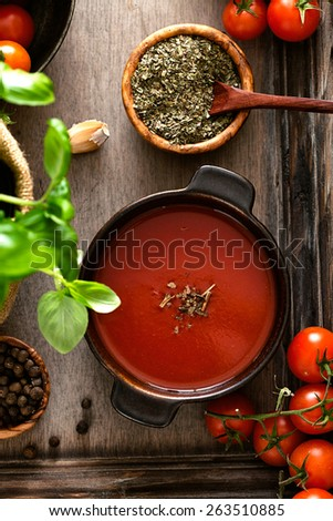 Tomato soup. Homemade tomato soup with tomatoes, herbs and spices. Comfort food. - stock photo