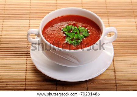 Tomato soup in ceramic bowl - stock photo
