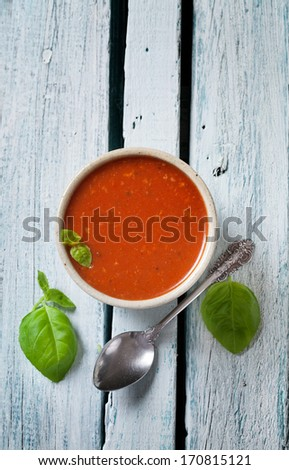 Tomato soup in rustic setting. Vegetable appetizer. - stock photo