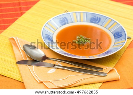 tomato soup on a table in restaurant