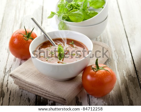 tomato soup with basil leaf on bowl - stock photo