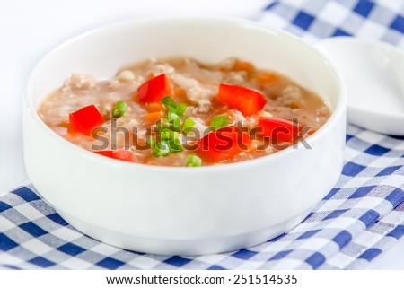 tomato soup with minced pork on white background - stock photo