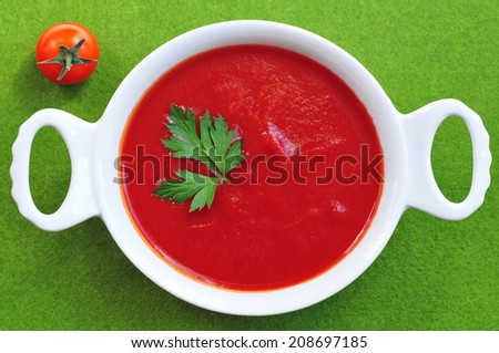 Tomato soup with parsley closeup - stock photo