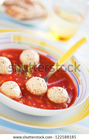 Tomato soup with vegetables and turkey meatballs, selective focus - stock photo