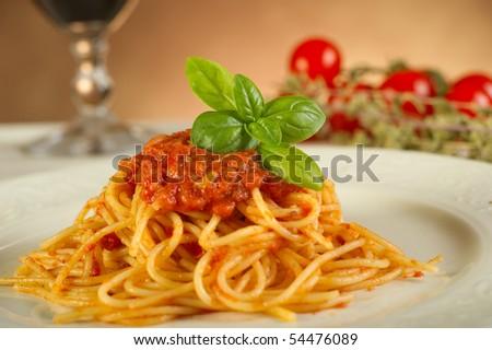 tomato spaghetti on dish - stock photo