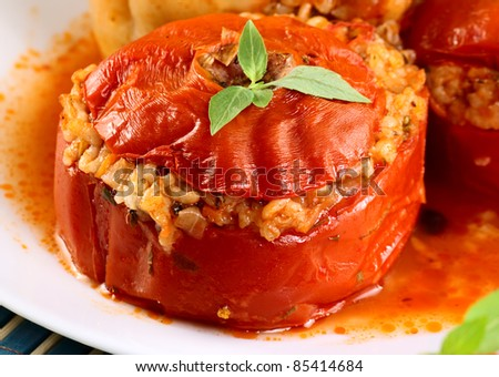 Tomato stuffed with rice and herbs closeup. - stock photo