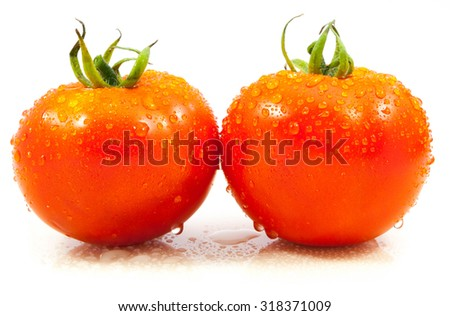 tomato with drops on white background - stock photo