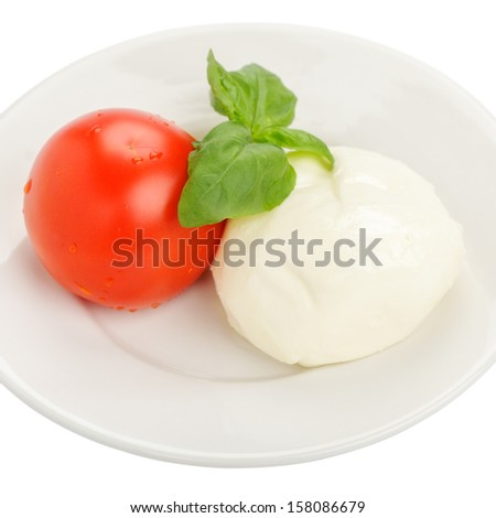 Tomato with mozzarella and basil on a white background