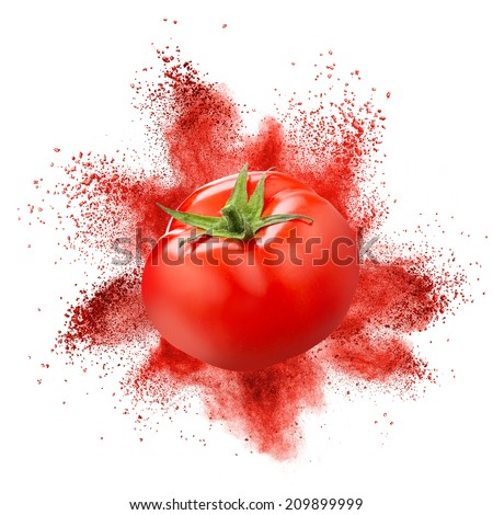 Tomato with red powder explosion isolated on white background - stock photo