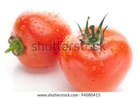 tomato with water drops isolated on white