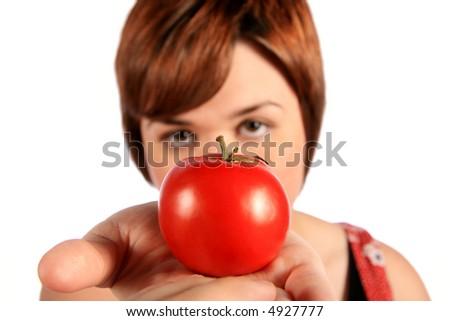 Tomatoe in hand (focus on tomato) - stock photo