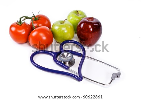 tomatoes and apples and heart shaped stethoscope - stock photo