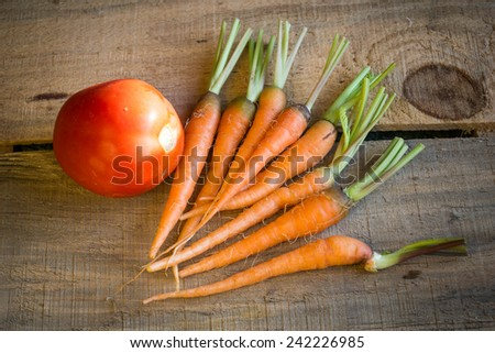 tomatoes and baby carrots - stock photo