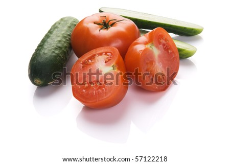 Tomatoes and cucumbers on white background - stock photo