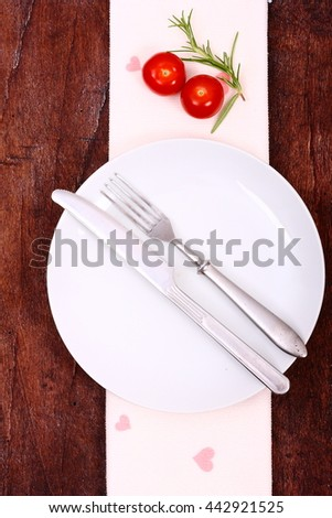Tomatoes and fresh herbs on a wooden table. Healthy vegetables background. - stock photo