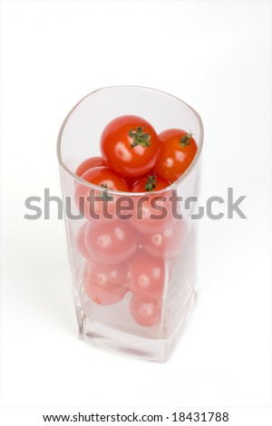 Tomatoes and juice on a white background