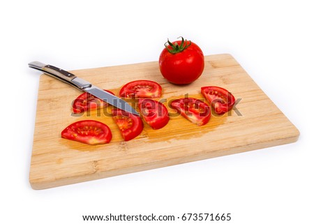 Tomatoes and knife on cutting board