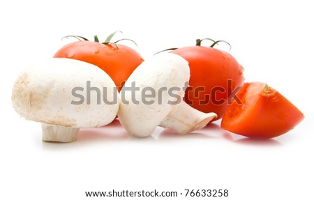tomatoes and mushrooms on a white background - stock photo