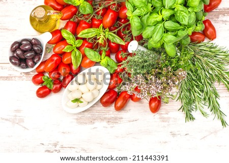 tomatoes, basil leaves, mozzarella and olive oil. food background. caprese salad ingredients - stock photo