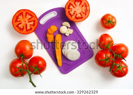 tomatoes , carrot , onion and garlic synthesis  - stock photo