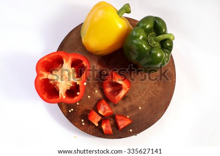 tomatoes , celery , corn and bell pepper on wooden cutting board  - stock photo