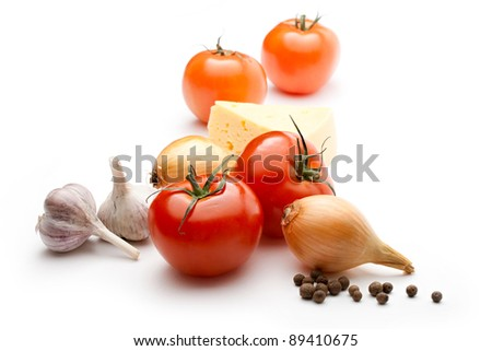 Tomatoes, cheese, onions, pepper and garlic isolated on the white background - stock photo