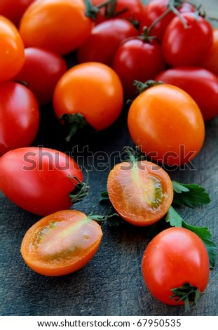 Tomatoes Cherry on a black wooden board - stock photo