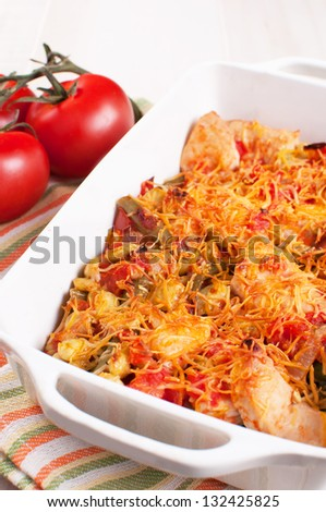 Tomatoes, chicken and cheese baked casserole - stock photo