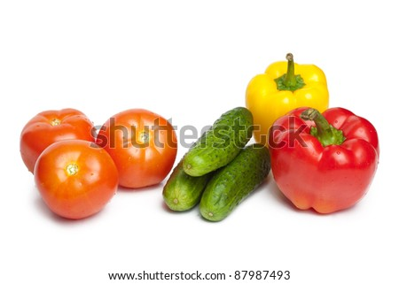 Tomatoes, cucumbers and peppers isolated over white background - stock photo