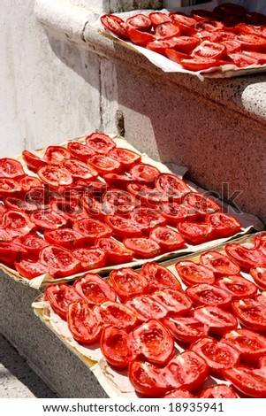 Tomatoes drying in the sun - stock photo