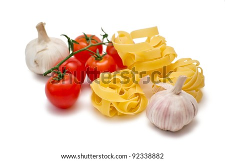 Tomatoes, garlic and fettuccine in a white background - stock photo
