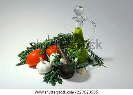 Tomatoes, garlic, olive oil and fresh spicy herbs for sauce preparation - stock photo