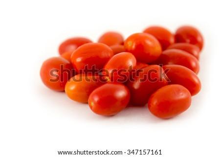 Tomatoes Grape cherry on white background - stock photo